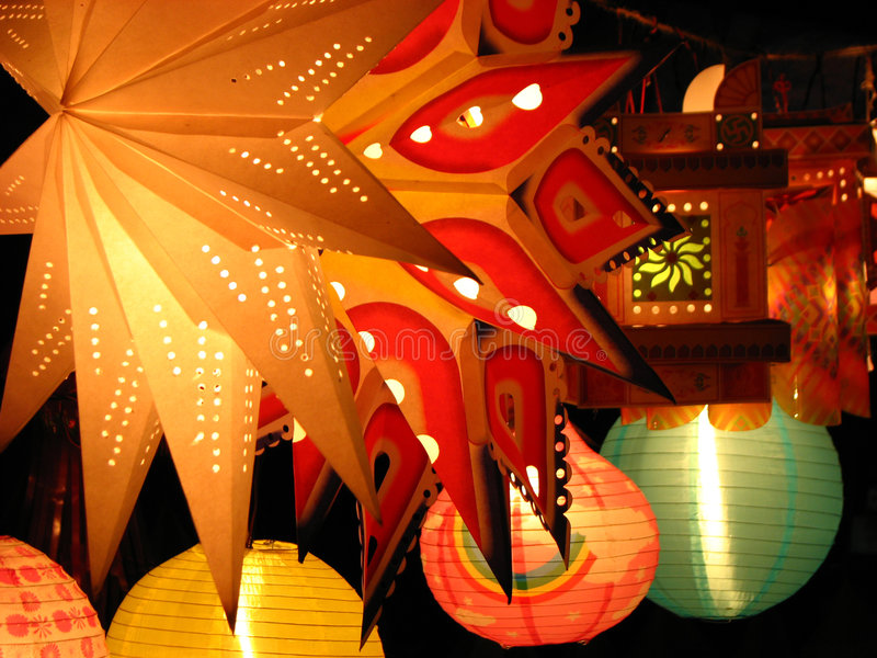 Star Lanterns. Beautiful star shaped skylanterns light up in a house on the first day of Diwali / Christmas festival celebrated worldwide by Indians stock photography