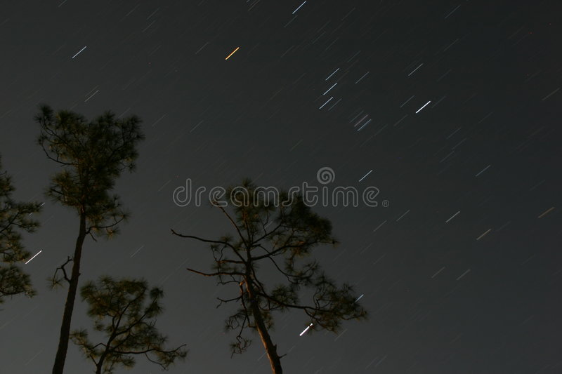 Star movements across night sky stock image