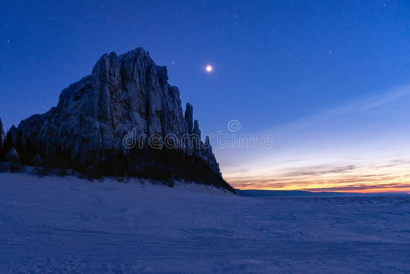 Star night on the Lena river in the Natural Park Lenskie Stolby Lena Pillars. Lena Pillars at sunset and star night on the Lena river in the Natural Park Lenskie royalty free stock images