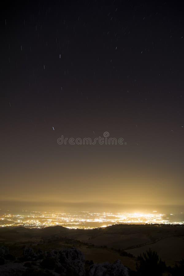 Star rainning. Stars rainning over city at night. Long exposed picture stock image