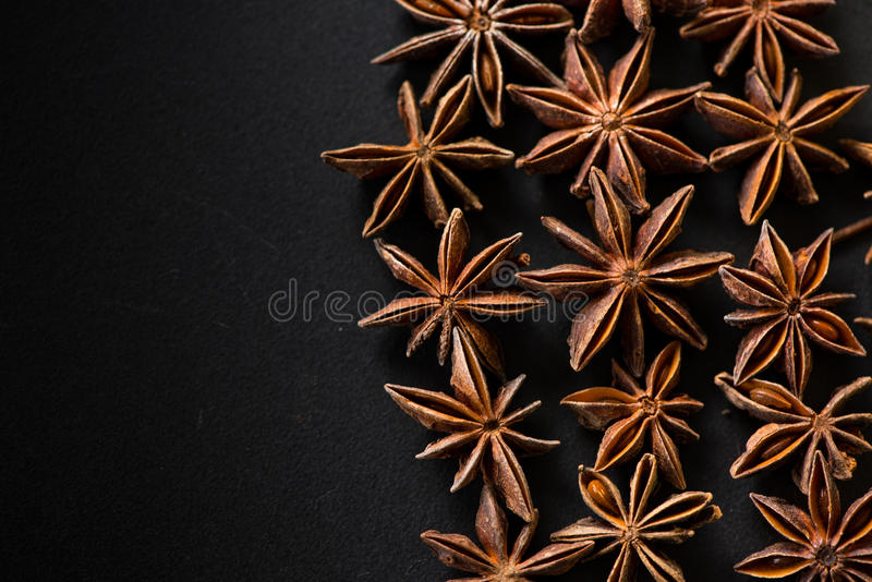 Star shape natural anis seed on black background stock photos