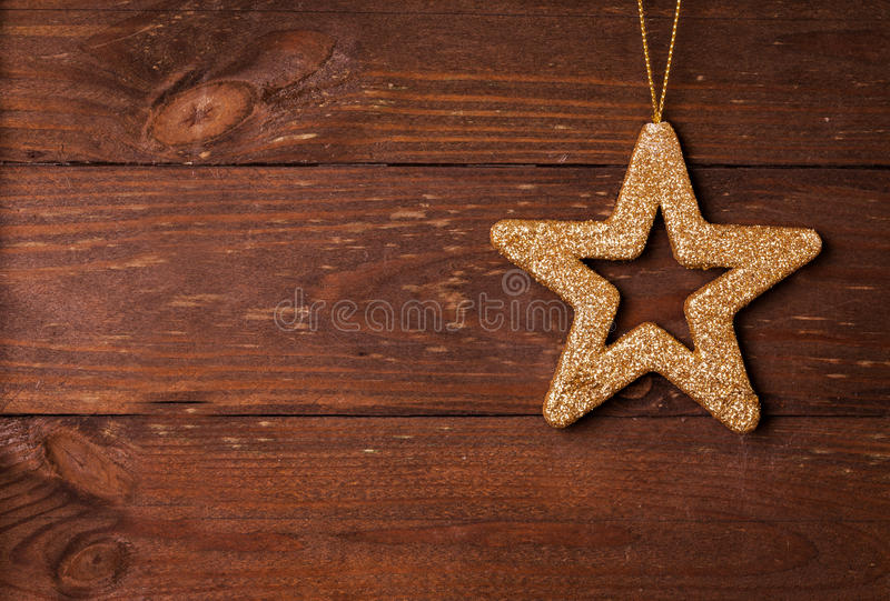 Star shape on wooden background royalty free stock image