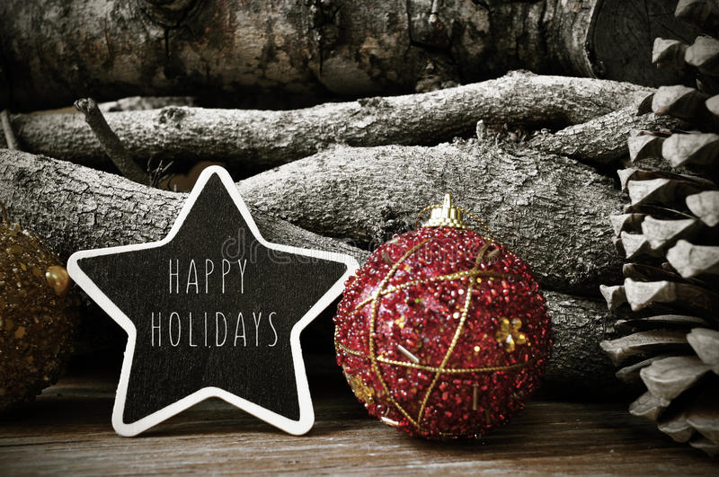Star-shaped chalkboard with the text happy holidays royalty free stock photography