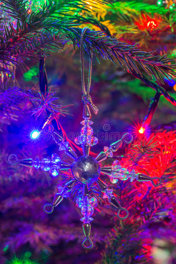 Star Shaped Christmas Ornament. Silver metal and clear plastic star shaped christmas tree ornament royalty free stock photography