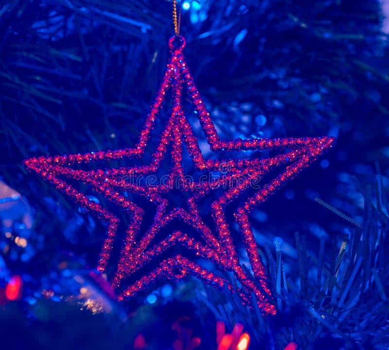 Star-shaped Christmas ornament, Christmas tree decoration.  royalty free stock photo