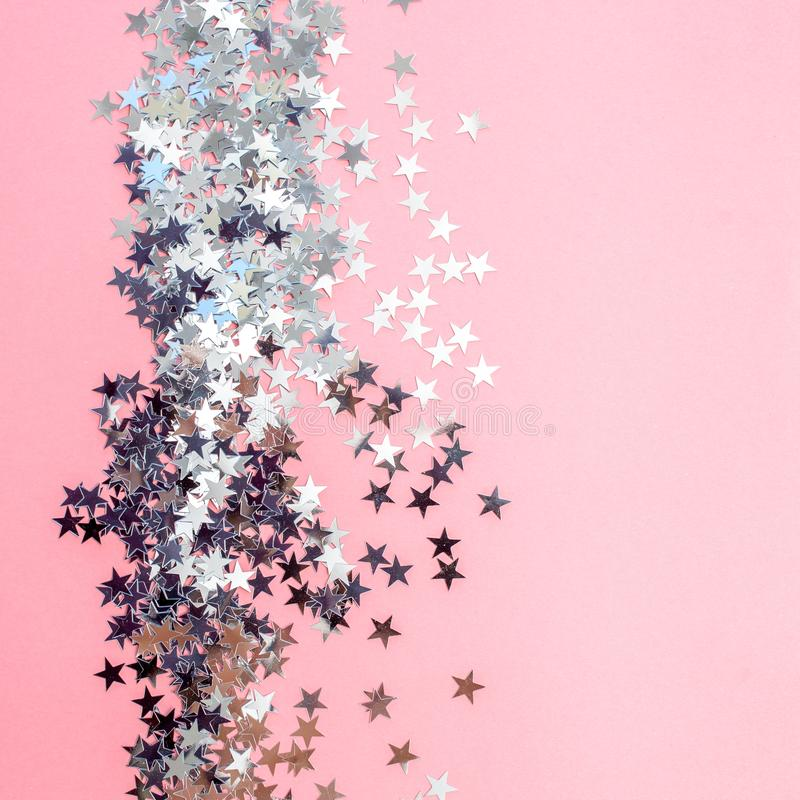 Star-shaped confetti scattered on a pink background. Celebration and party, concept. Copy space royalty free illustration