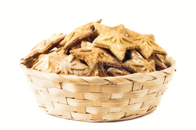Star-shaped cookies in a wicker natural basket, isolated on a white background. Shortbread. Gingerbread Cookie. royalty free stock images