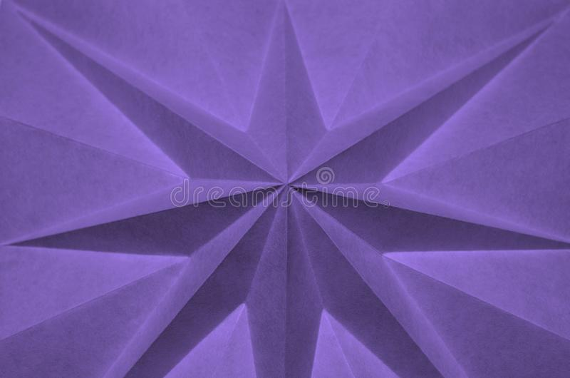 Star shaped folded paper as abstract background. stock image