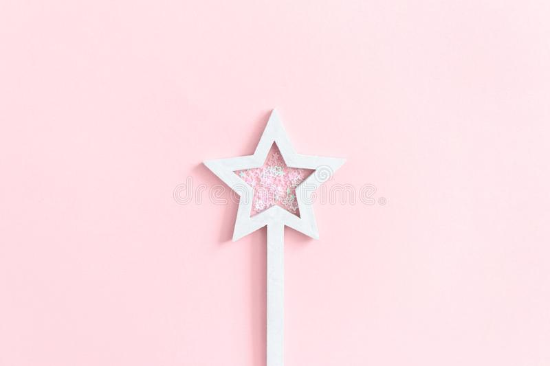 Star shaped magic wand with sequins stock photo