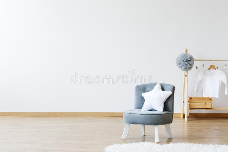 Star shaped pillow on chair royalty free stock image