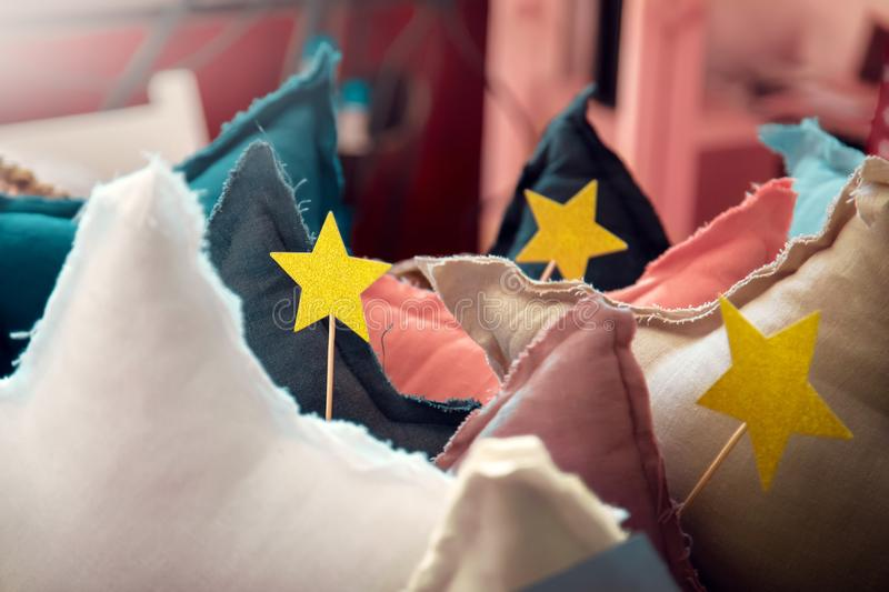 Star shaped pillows in the bedroom royalty free stock image