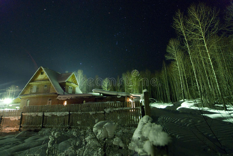 The star sky and Orion over winter village! stock image
