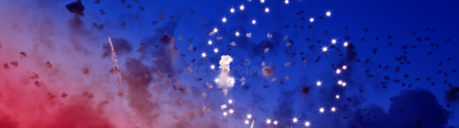 Star Spangled Banner. Fireworks over a deep blue sky symbolizing Independence Day in the USA stock photography