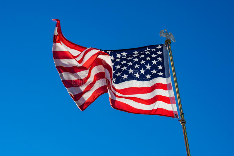 Star spangled banner with blue sky.  royalty free stock image