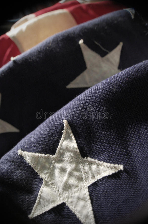 Star Spangled Banner. Close-up shot of an old and weathered American flag stock image