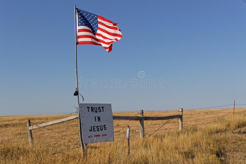 Star spangled banner flag and a message over the couuntryside of South Dakota. UNION CENTER, SOUTH DAKOTA, September 7, 2018 : Star splanged banner flag and a stock photography