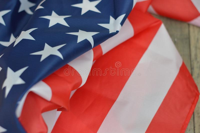 Stars and stripes on a wooden background stock photography