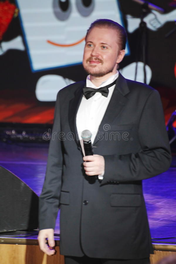 Star of stage, Opera singer, tenor Sergey Muravyov acts, sings the formal tuxedo costume. On the stage of a nightclub Olympia, Saint Petersburg, Russia, Europe stock photo
