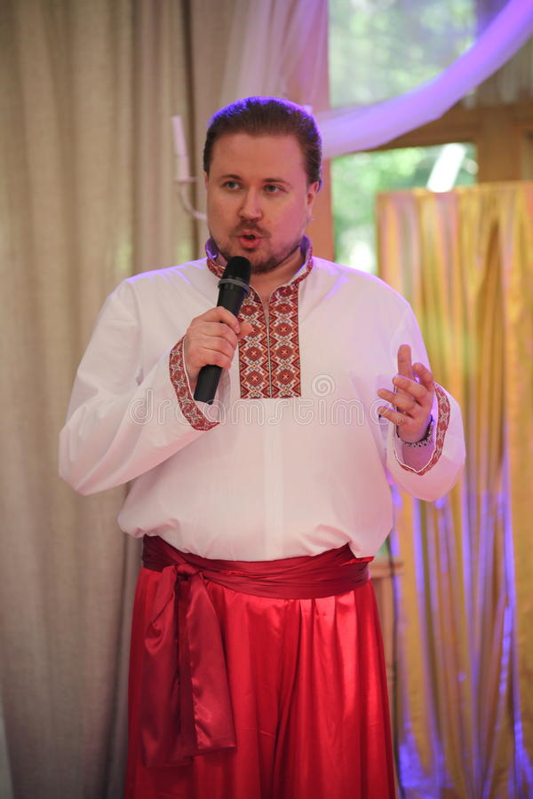 Star of stage, Opera singer, tenor Sergey Muravyov acts, sings the national Ukrainian Russian costume. At the presentation of the menu of Ukrainian national royalty free stock photo
