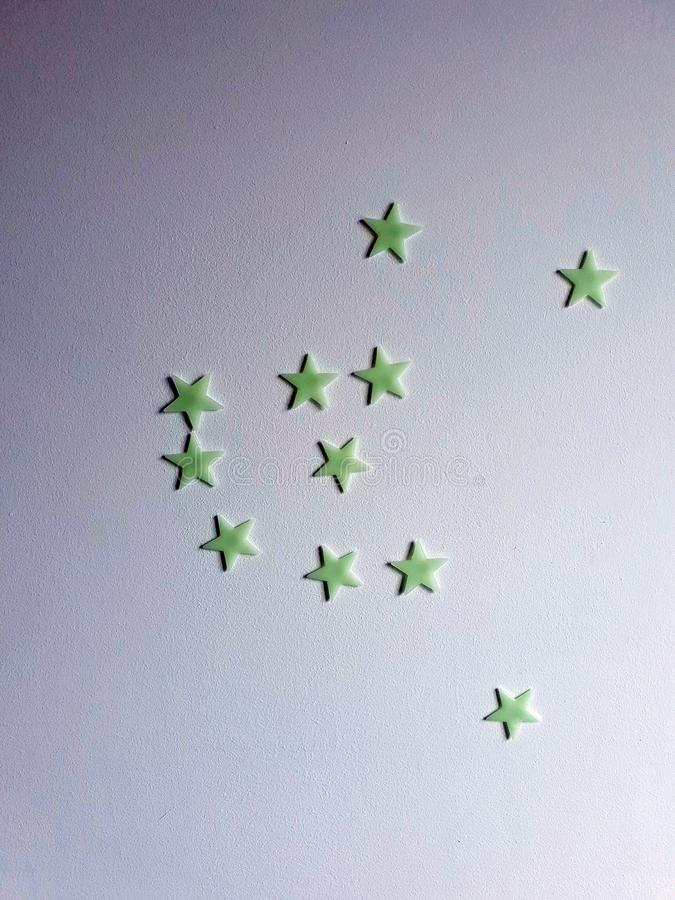 Star stickers plastered on the wall background texture, space for text stock photos