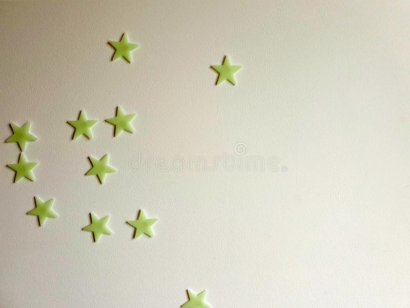 Star stickers plastered on the wall background texture, space for text stock images