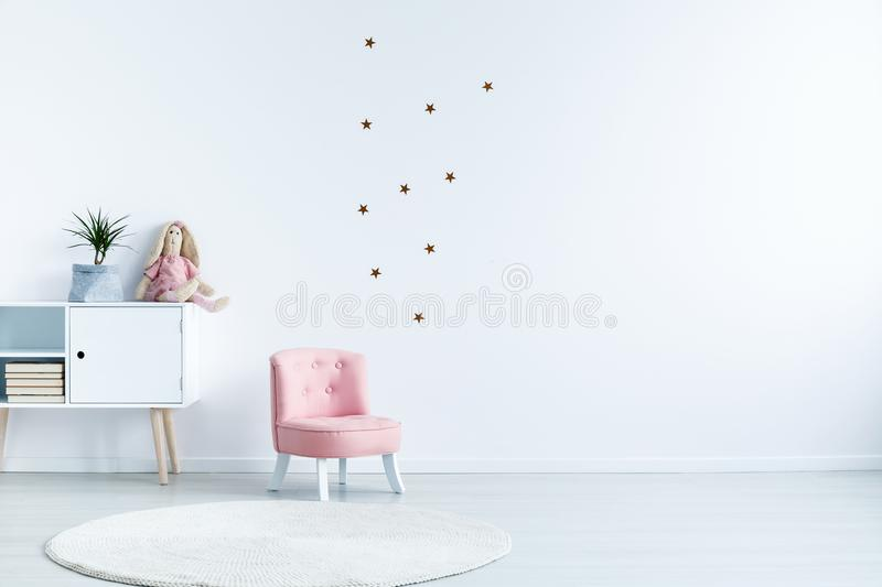 Star stickers on white wall with copy space in child`s room inte stock photography