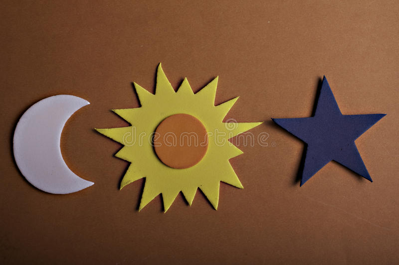 Star sun and moon. Stars sun and moon on a orange background royalty free stock images