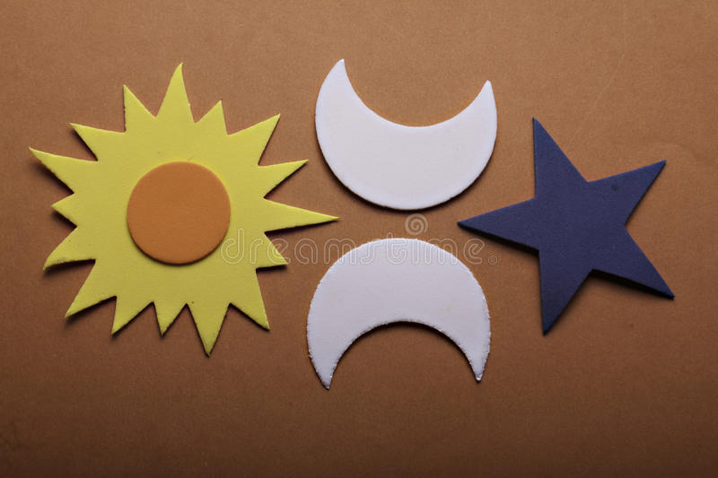 Star sun and moon. Stars sun and moon on a orange background stock photography