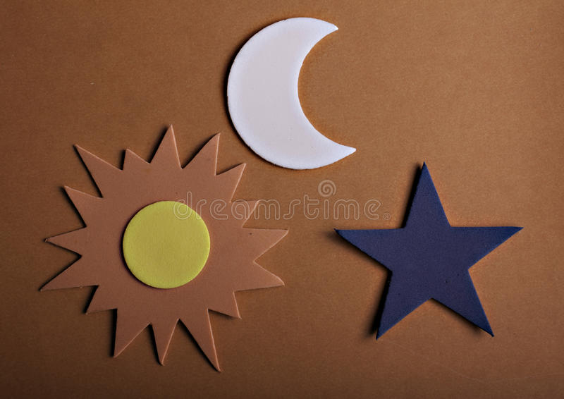 Star sun and moon. Stars sun and moon on a orange background royalty free stock photography