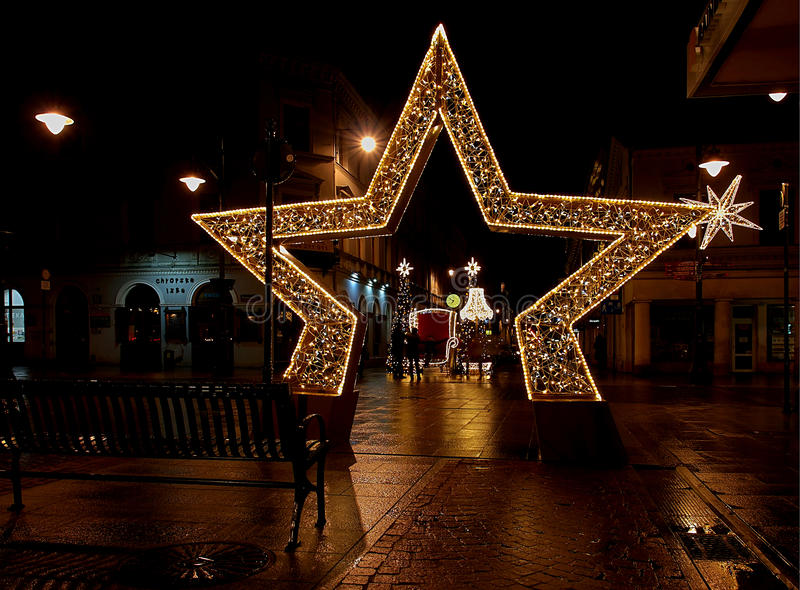The star and the throne. Illuminated Christmas star and a throne for Santa Claus on the street Piotrkowska royalty free stock photography