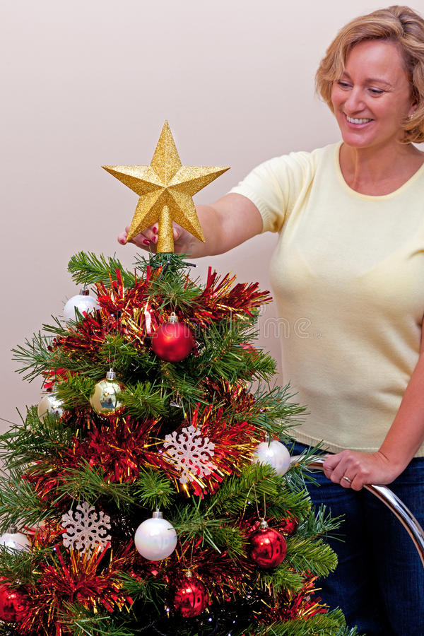 Download Star On Top Of The Christmas Tree Stock Image - Image of decorating, people: 27203661