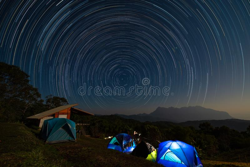 Star trail above Doi Luang mountain seen from Doi Ma Taman camping site royalty free stock images