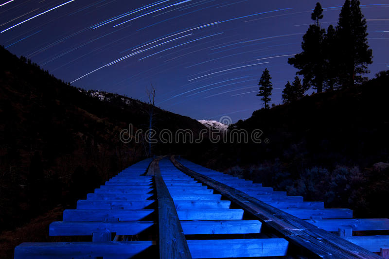 Star Trail And Blue Light Flume Stock Photos