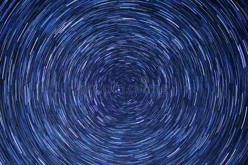 Star trail circle-space-night-blue stock images