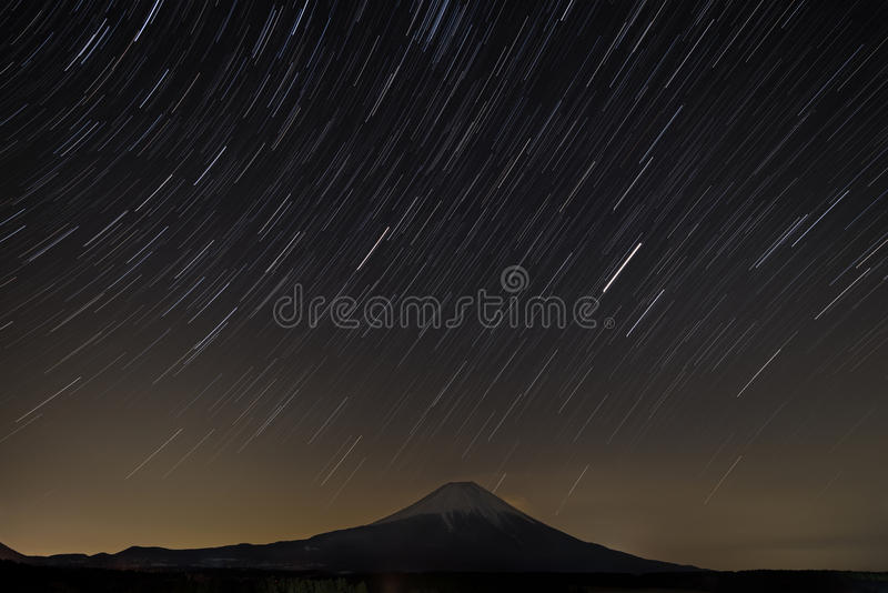 Star trail with Fuji. In the night royalty free stock photo