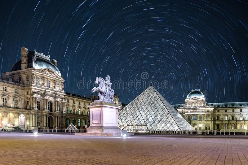 Star Trail at The Louvre. Paris stock photo