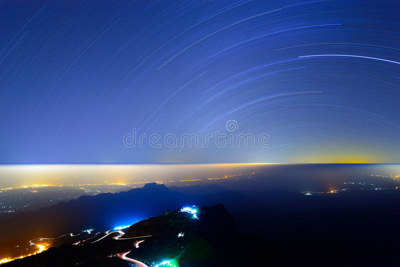 Star trail over the mountain stock image