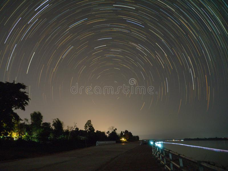 Star trail and the riverside road royalty free stock images