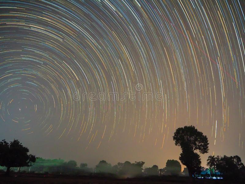 Star trail at sisaket thailand. Startrail over rice fields At Sisaket, Thailand stock image