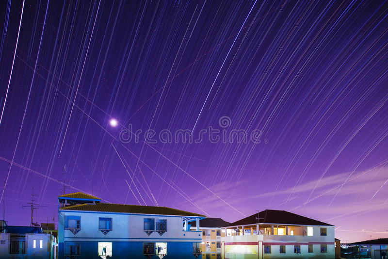 Star trails Across Plane Light Trails stock photography