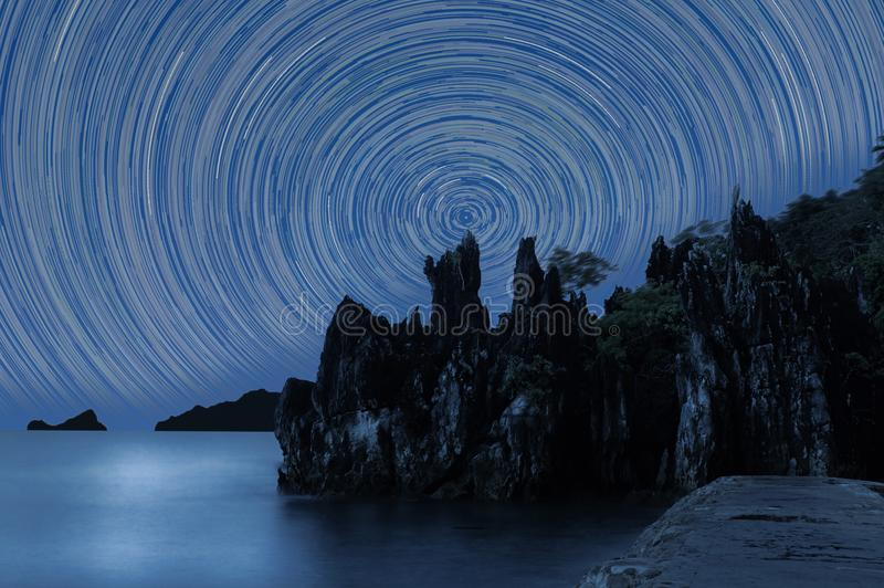 Star Trails Against rugged rocks silhouette. Picture of Star Trails Against rugged rocks silhouette in the Philippines stock photos