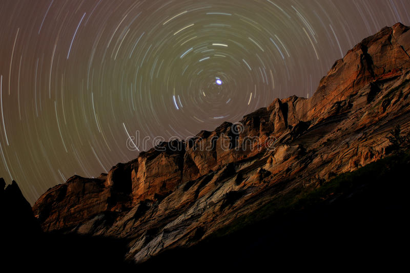 Star Trails around Polaris above Desert Cliffs stock photography