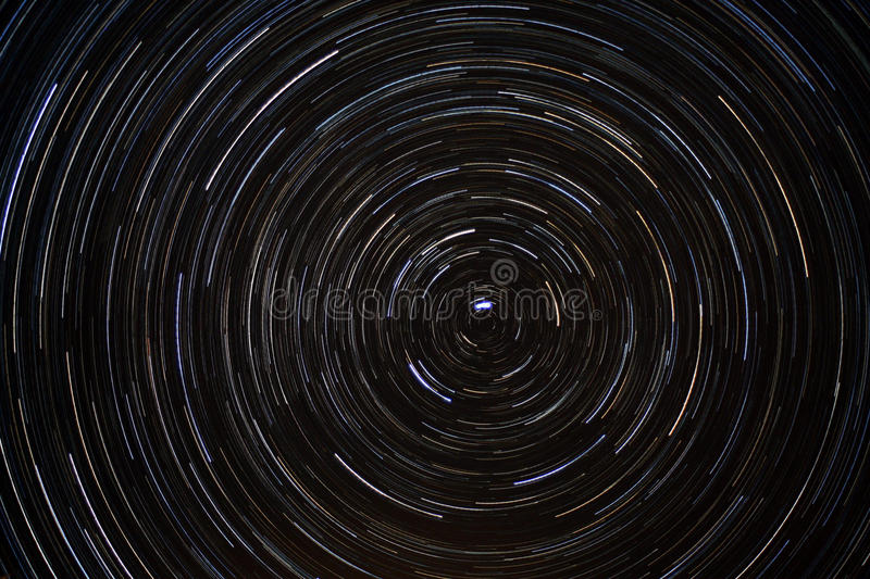Star Trails around Polaris (North Star). The earth's rotation causes the stars to appear to move in circular arcs around the north star royalty free stock image
