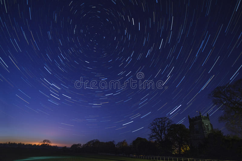 Star Trails - Astronomy - Space. Astronomy - Star Trails in early Spring above a church in a small village in North Yorkshire in the United Kingdom royalty free stock image