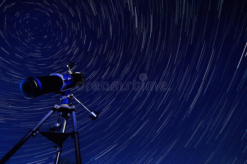 Space - Star Trails - Astronomy. Astronomy - Star Trails in the early Spring sky in North Yorkshire in the United Kingdom. The star trails appear to rotate royalty free stock photo