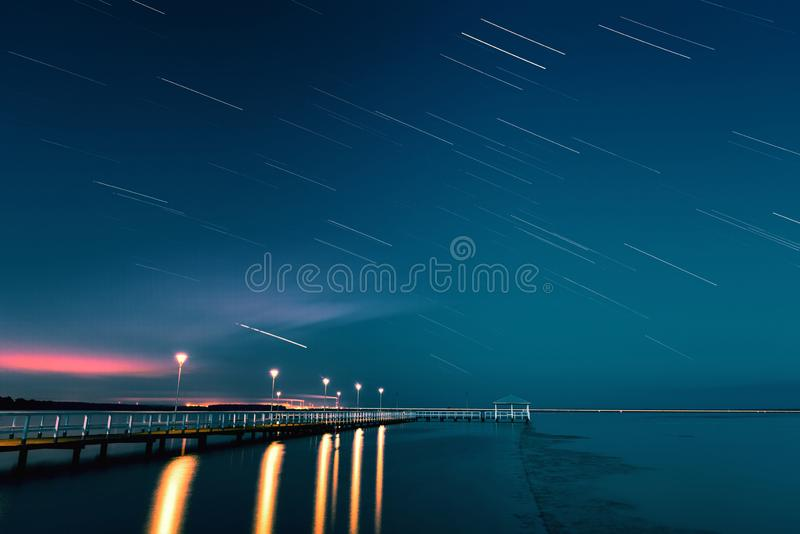 Star Trails, Beautiful Blue Night reflection.Clear night sky Star trails over the lake royalty free stock photo