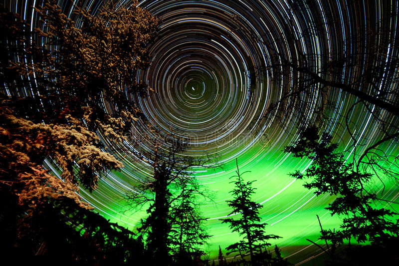 Download Star Trails And Northern Lights In Sky Over Taiga Stock Image - Image of dark, luminosity: 93381977