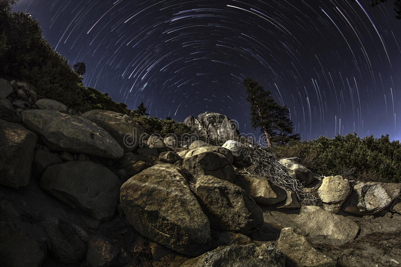 Star trails over boulder royalty free stock photo