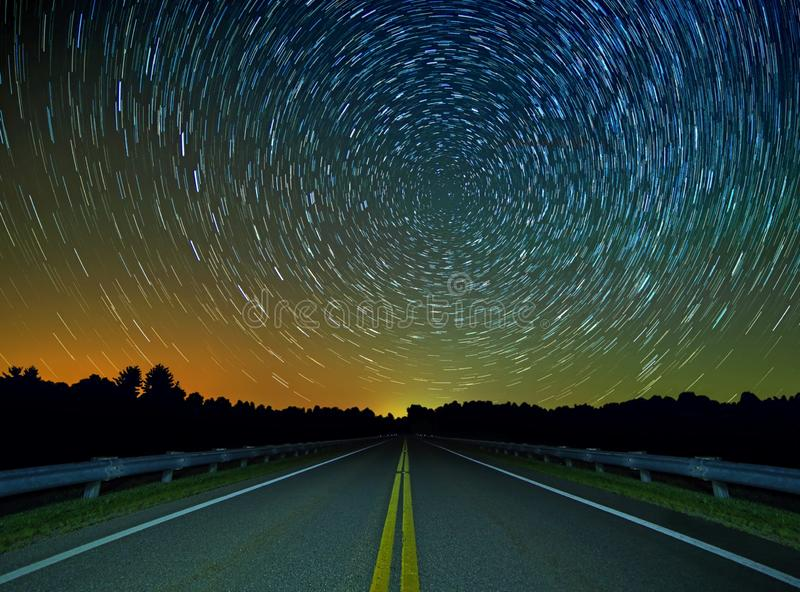 Star Trails Over a Country Road stock image