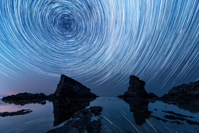 Star trails over the rock phenomenon The Ships stock image